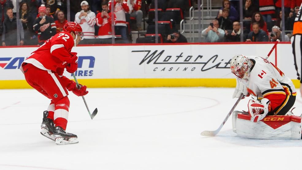 7b17511a173 Detroit Red Wings center Andreas Athanasiou (72) scores on a penalty shot  against Calgary Flames goaltender Mike Smith (41) in the second period of  an NHL ...